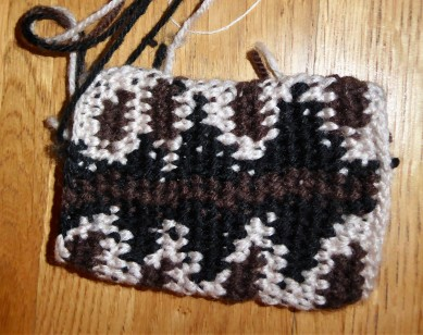 Current version. Instead of trying to lay down the pattern, get the stripe straight and increase stitches all at the same time, I'm starting from the neck end and will then reduce. My colour changes *still* aren't perfect and nor is the pattern, but on we go.