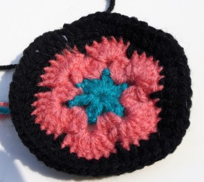My attempt at an African flower hexagon. Too gappy, and the shape isn't quite right.