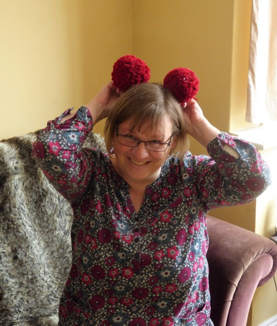Tattysquawk modelling a couple of pompoms. It might have got a little silly.