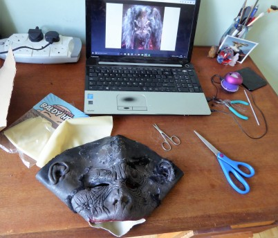 I cut off the hair from the gorilla mask, then started ripping it off the face, using pliers a great deal of BFI.