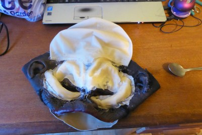Other whole bald cap folded in half and hot-glued on to extend forehead. Note spoon handle for smoothing things down because hot glue is hot, even through a couple of layers of latex.