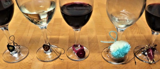 Our last night. There was a running challenge to create wine charms. Left to right : Clare and Duncan's leather charms, Gaie's braid and button, my pompom, Dave's miniature leather mask. Cheers all! It was a lovely holiday.