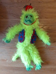 There was no flow to making this monkey.I think his waistcoat is a depressing colour against the neon green. I also feel like he needs a hoop and a little dog to jump through it, and the fear of screwing up the dog is preventing me from even starting.