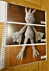 It's a genius mash-up between a make-a-monster flip book and crochet patterns to make the parts.