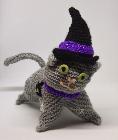 ... Mystic the witchy cat (knit cat #2). She has glow in the dark embroidered stars.