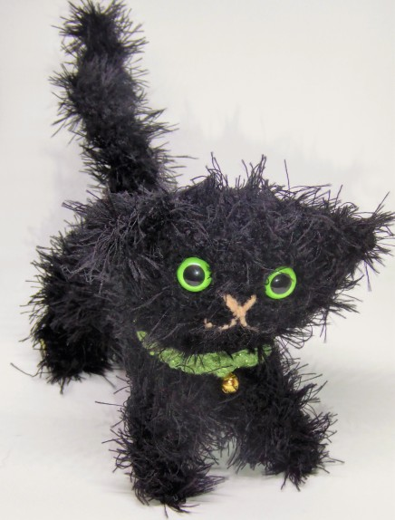 Crochet cat #5, Hobb. She has glow in the dark eyes. Also, a long body so something went awry with the stitch count there. I thought I remembered the pattern, but clearly not.