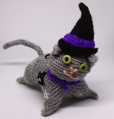 Knitted cat #2, Mystic, cat size. Made with plain acrylic DK yarn, but came out smaller that comparable crochet cat (Socks).