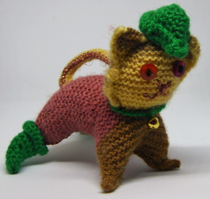 Knitted cat # 4, Robin. Spent a ridiculous amount of time working out how to do his boots, and then decided they had to be green, not red. Also, part of me insisted on a hat to go with them. His bum has a copper patch where I had to darn up a hole.