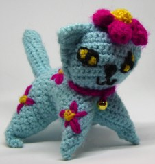 Recap of cats already made. Sky, crochet cat #1, kitten size, made with acrylic DK yarn. That bit of me that sometimes drives me nuts insisted that all the cats with collars had to have bells.