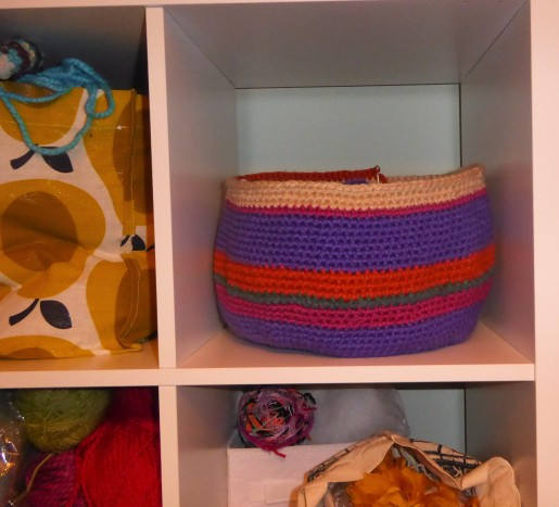 For scale, here it is in my new Kallax shelves. All my yarn has migrated there now, hooray! It doesn't look like the Ikea catalogue due to my habit of shoving things in shopping bags. (At least I've got the Orla Kierly Tesco bag on display). But no more unstacking 5 massive storage boxes to get to my chunky yarn! Hoorah!