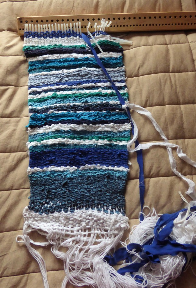 The unfinished rag rug on my big peg loom.