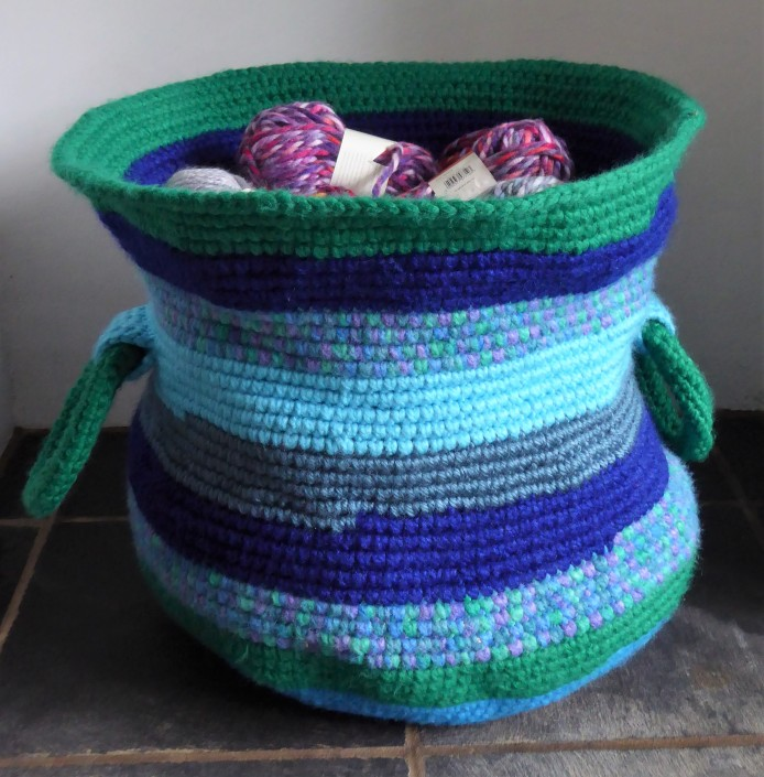 The basket full stuffed with a LOT of yarn balls! Still not totally rigid, but I think that's part of its charm.