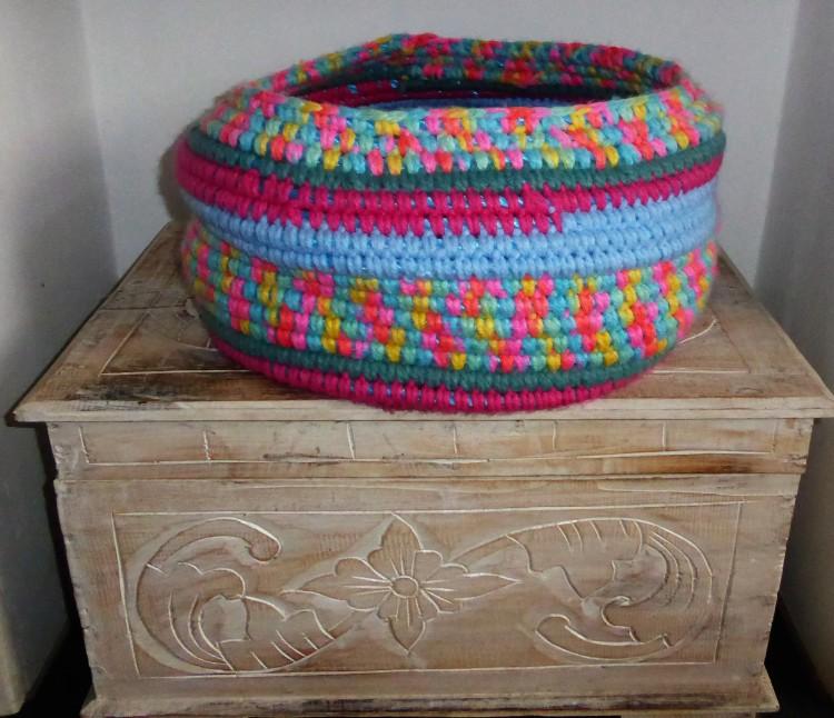 The multicoloured yarn is Sirdar Super Chunky Flamingo.