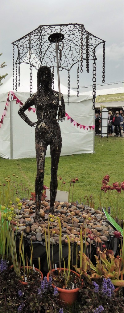 This clever sculpture made from all sorts of scrap parts is also a water feature. The sculptor, Paul Thomas, told me started with the umbrella frame, which he found discarded in the street, and worked from there.