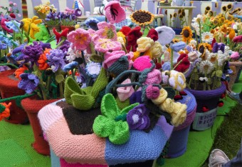 A closer view of some of the knitted flowers.