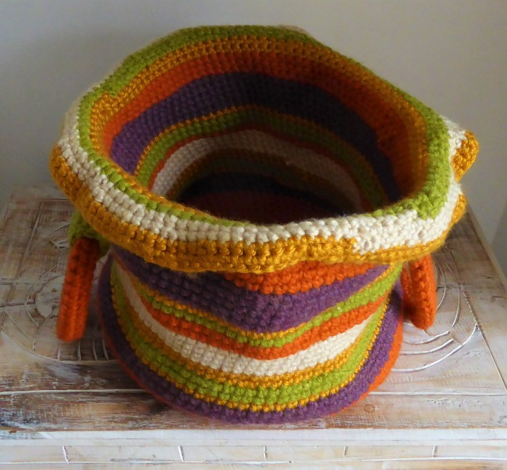 Basket for repeat customer with metallic gold chunky yarn. Shiny.