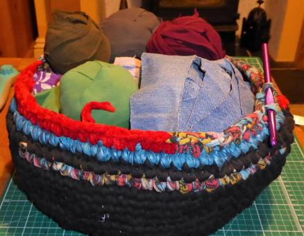 Haven't finished this yet, and I'm already using it to hold more fabric yarn. So far made from 5 black T shirts, a dress I used to wear in the 80's, some shiny blue leggings I bought for an 80's party that went funny in the wash, and the bodice of a tacky Miss Santa costume.