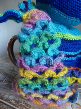 The dragon scales take up a lot of yarn, but show off the rainbow graduation nicely. I used two different rainbow yarns.