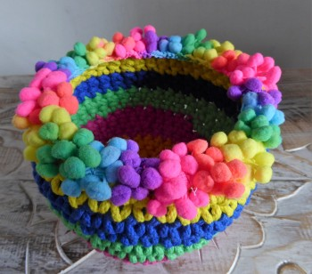 The pompom trim is crocheted on from the inside to give a nice finish.