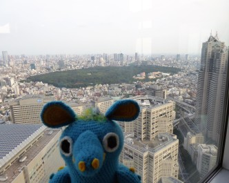 Mr. Bobbles getting an overview of the city from the South Observation Tower at the Tokyo Metropolitan Government Buildings. (Free!)