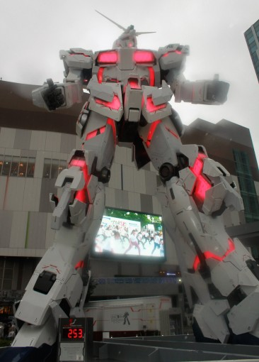 A giant stompy light-up robot outside. It's a Gundam.