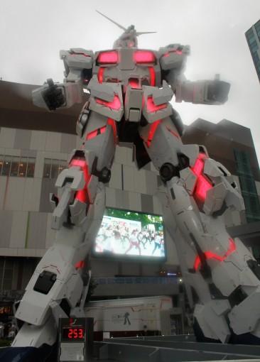 A giant stompy light-up robot outside. It's a Gundam.