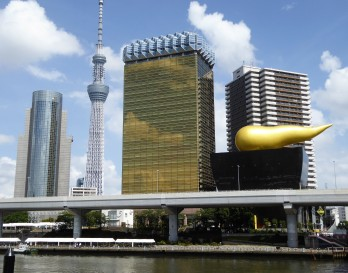 A view along the river with the SkyTree and the Asahi building that looks like a giant glass of beer.