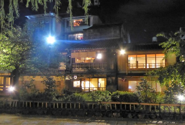 The traditional wooden tea houses lit up at night. These are not cafés, they're the most exclusive restaurants in town.