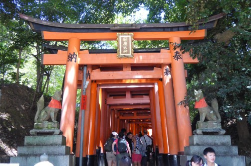 The path passes up the mountain though thousands of these red torii (gates).