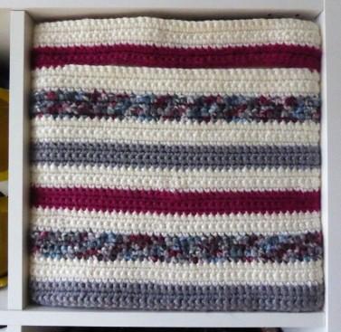 A crocheted cover for a DRÖNA storage box.