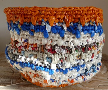 Finally confident enough to offer a plarn basket for sale. It also has a reinforced base and all of the ends woven in. But weaving the ends in takes longer than crocheting the basket!