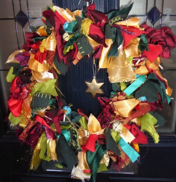 Last minute rag wreath. Pretty pleased with the way it turned out. Helps that we have a pretty varied scrap stash, as partner makes LARP costumes.